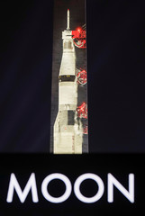 An image of the Saturn V rocket is projected onto the side of the Washington Monument to mark the 50th anniversary of the first lunar mission