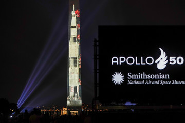 An image of the Saturn V rocket is projected on to the side of the Washington Monument to mark the 50th anniversary of the first lunar mission in Washington