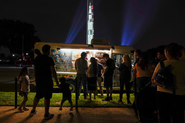 An image of the Saturn V rocket is projected onto the side of the Washington Monument to mark the 50th anniversary of the first lunar mission in Washington