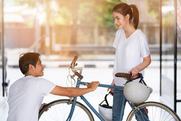 Traveling couple standing and checking the Bicycle at home before traveling