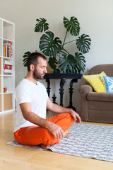 Man practicing yoga and meditation at home. A series of yoga poses. Lifestyle concept