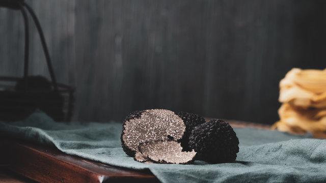 Black truffles mushrooms on rustic wooden table