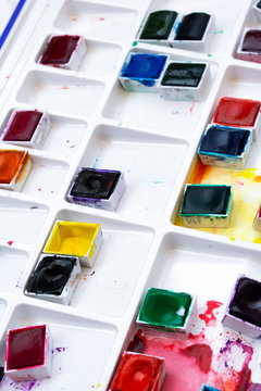 Colourful Watercolour Pallet of Messy Used Half Pan Paints