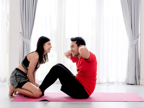 Happy Asian couple exercise at home together, lifestyle concept.
