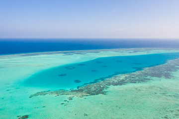 Foto op Aluminium Tunesië Atoll and blue sea, view from above. Seascape by day. Turquoise and blue sea water.