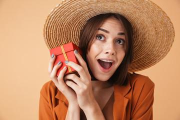 Beautiful young woman wearing straw hat