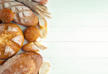 Door stickers Bread Assortment of baked bread on wooden table background