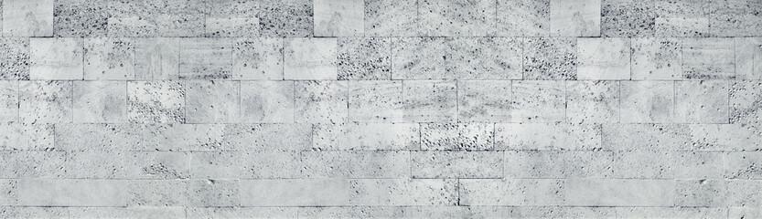 Tuff stone block wall wide texture. Gray rough masonry panorama. Long grunge background