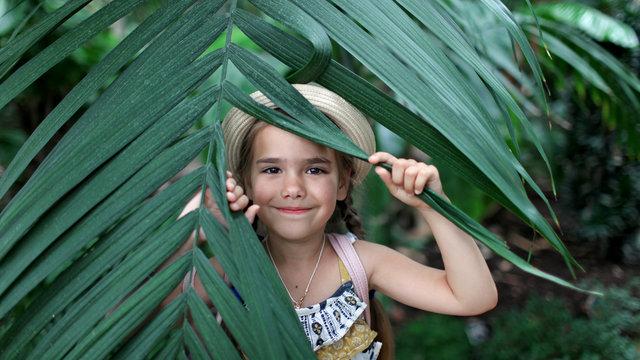 Kid in tropical garden