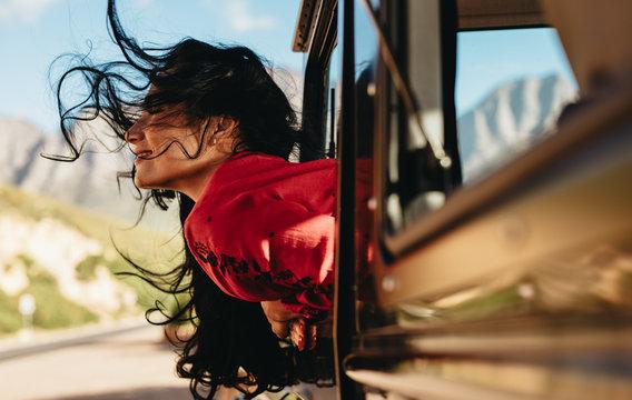 Woman enjoying a car ride