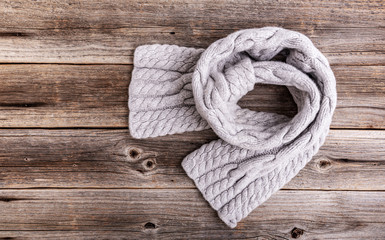 Winter scarf on a wooden background.