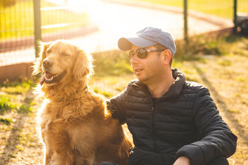 Young man having a fun with dogs in the nature stock photo