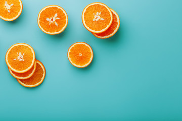 Slices and slices of orange pulp on a bright blue background as a textural background, the substrate. Full screen Flat lay, top view. Food background