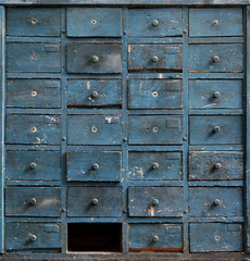 Old blue wooden cabinet with drawers