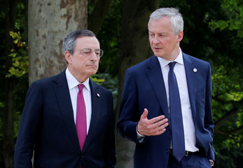 President of the European Central Bank (ECB) Mario Draghi and French Finance Minister Bruno Le Maire walk in the garden before a family photo during the G7 finance ministers and central bank governors meeting in Chantilly