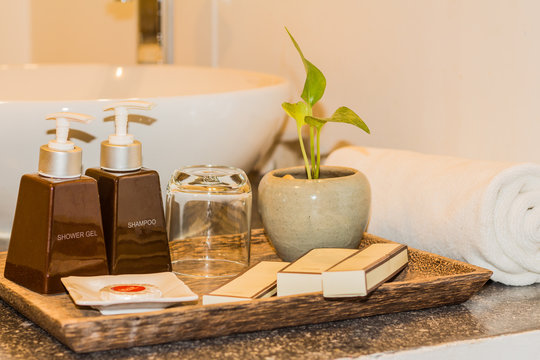 Hotel and spa amenities on a wooden tray