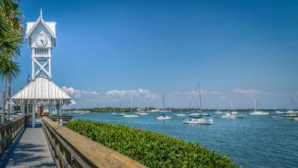 Small boats docked next to the historic Bradenton Beach pier on Anna Maria island.