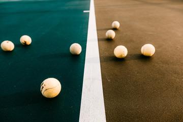 Close up of tennis balls on tennis court