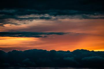 Sunset between dark cloud lines
