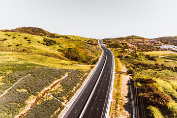 Aerial view of empty highway through rural landscape