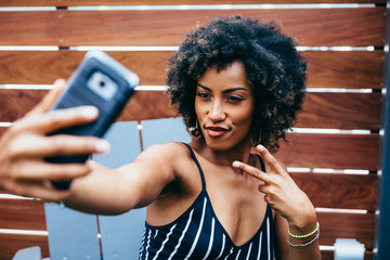 Woman taking a selfie outdoors