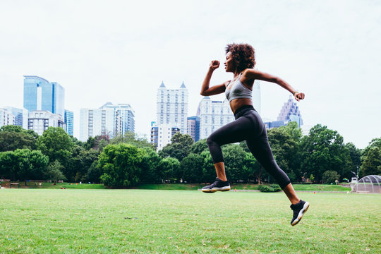 Young woman exercising in city park