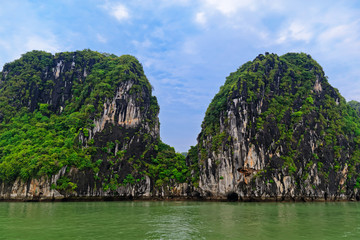 Green rocky islands in Ha Long bay, Vietnam