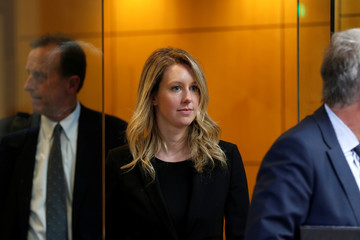 Former Theranos CEO Elizabeth Holmes leaves after a hearing at a federal court in San Jose