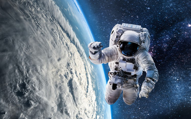 Printed roller blinds Nasa Astronaut in the outer space over the planet Earth. Abstract wallpaper. Spaceman. Elements of this image furnished by NASA