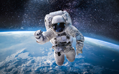 Garden Poster Nasa Astronaut in the outer space over the planet Earth. Abstract wallpaper. Spaceman. Elements of this image furnished by NASA