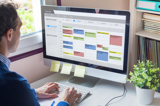 Calendar software showing busy schedule of manager with many meetings, tasks and appointments during the week, time management organization at work concept, business person using agenda on computer
