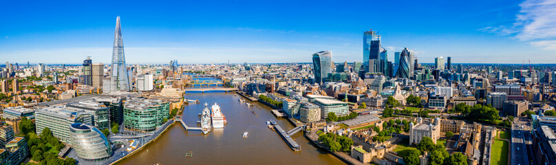 Wall Mural - Aerial panoramic cityscape view of London and the River Thames, England, United Kingdom. Close up view of the city of London district.