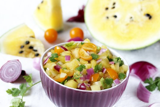 salsa salad of yellow watermelon. watermelon salsa. yellow watermelon. unusual dish. square format
