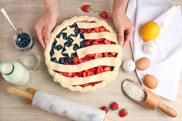 Woman making American flag pie in kitchen
