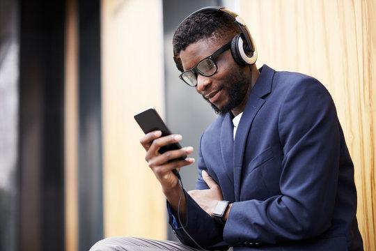 Man in headphones walking down the street.