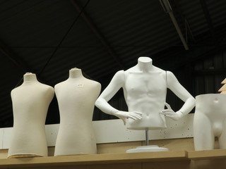 set of pieces of mannequins against a black background in a barn