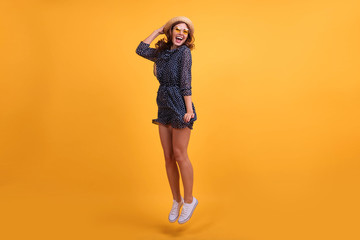 Full length body size view photo pretty lovely girl impressed astonished new sneakers shoes scream shout summer feel satisfied content rejoice dressed in modern clothing isolated yellow background