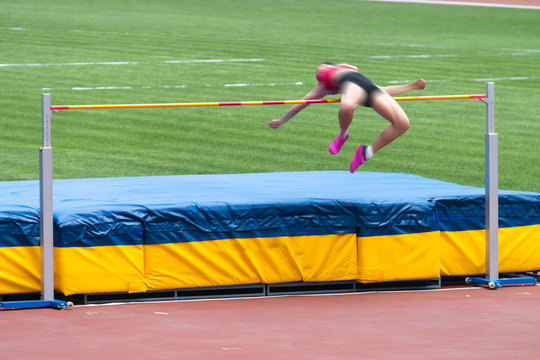 Athletes in high jump competition