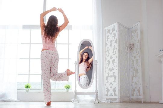 woman dancing near mirror