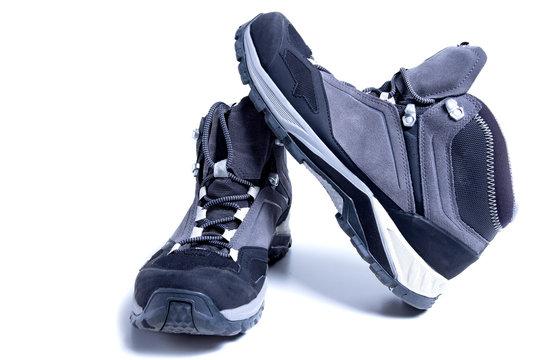 Trekking shoes isolated on white background