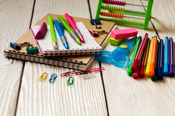 School and  office supplies on a wooden background