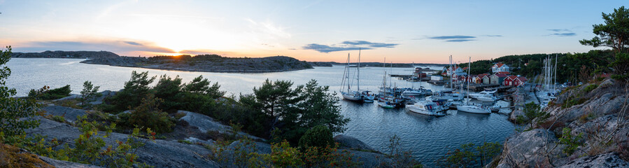 View into the sailing and fishing harbour of Resö during sunset, western Sweden.