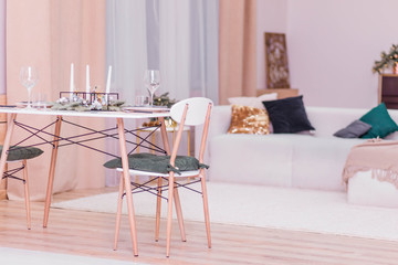Table setting in the New Year's style. Simple and stylish interior rooms in the New Year's style