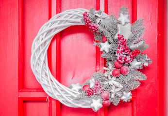 silver Christmas wreath hanging on the Christmas door