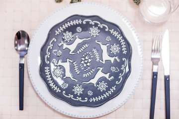 decorative plate with painted deer as part of the New Year's serving