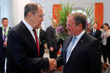 Russian Foreign Minister Sergei Lavrov shakes hands with Armin Laschet at Petersberg mountain on the sidelines of the so-called Petersburg Dialogue to speak on the conflict in Ukraine and the future of arms control in Koenigswinter