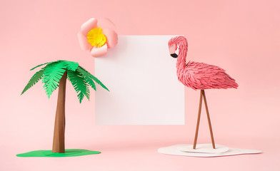 Wall Mural - Tropical background with palm tree, pink flamingo, flower and paper card note. Creative summer concept. Minimal art