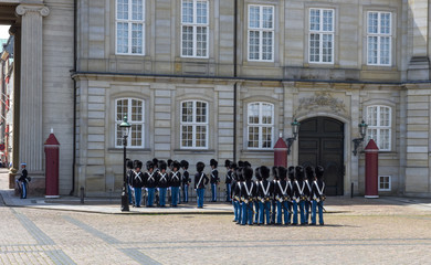 Changing of the guard at Amalienborg palace on town square in Copenhagen, Denmark