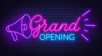 Grand opening neon sign on dark background. Papier Peint