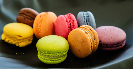 Printed kitchen splashbacks Macarons Colorful macarons on black background, close up view